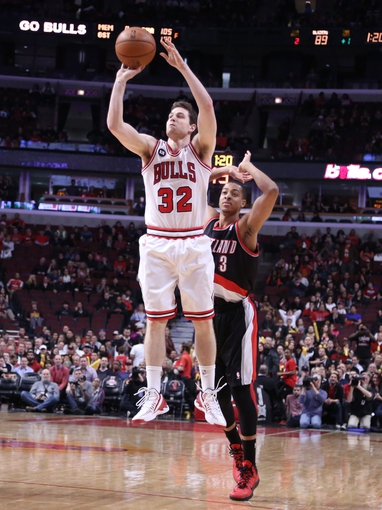 Mar 28, 2014; Chicago, IL, USA; Chicago Bulls guard Jimmer Fredette (32) shoots over Portland Trail Blazers guard C.J. McCollum (3) during the second half at the United Center. Portland won 91-74. Mandatory Credit: Dennis Wierzbicki-USA TODAY Sports