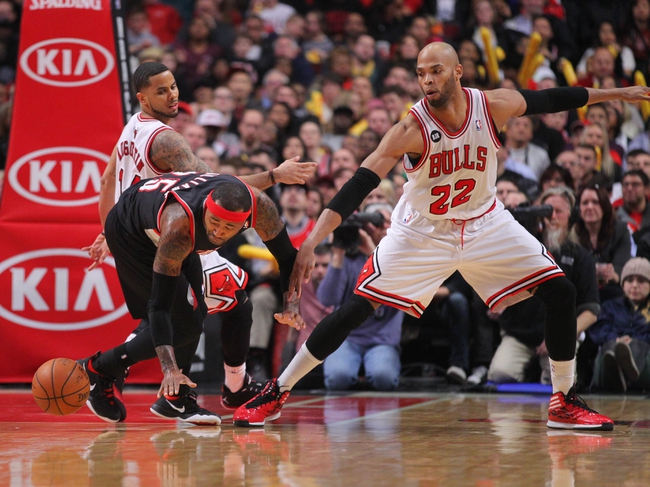 Mar 28, 2014; Chicago, IL, USA; Portland Trail Blazers guard Mo Williams (25) and Chicago Bulls forward Taj Gibson (22) fight for a loose ball during the second half at the United Center. Portland won 91-74. Mandatory Credit: Dennis Wierzbicki-USA TODAY Sports