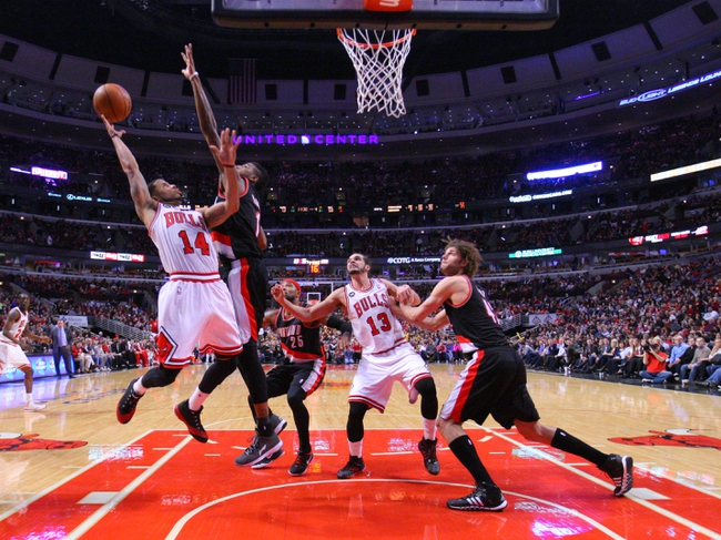 Mar 28, 2014; Chicago, IL, USA; Chicago Bulls guard D.J. Augustin (14) shoots over Portland Trail Blazers forward Dorell Wright (1) during the second half at the United Center. Portland won 91-74. Mandatory Credit: Dennis Wierzbicki-USA TODAY Sports