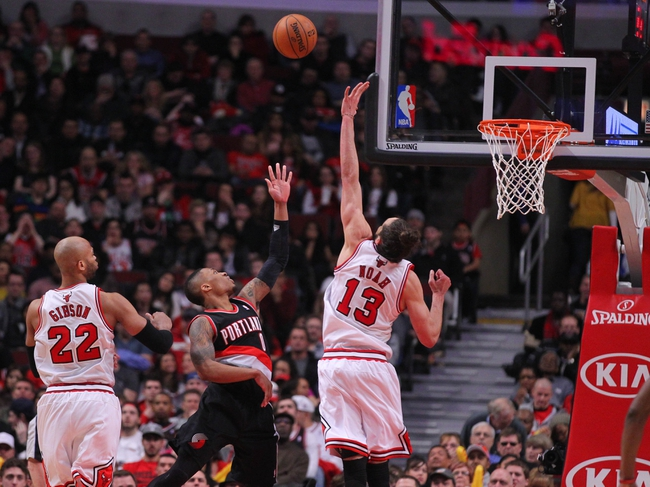 Mar 28, 2014; Chicago, IL, USA; Portland Trail Blazers guard Damian Lillard (0) scores over Chicago Bulls center Joakim Noah (13) during the second half at the United Center. Portland won 91-74. Mandatory Credit: Dennis Wierzbicki-USA TODAY Sports