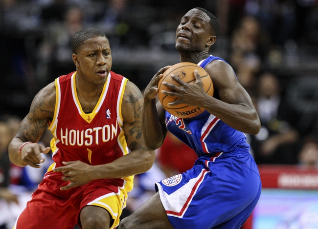 Mar 29, 2014; Houston, TX, USA; Los Angeles Clippers guard Darren Collison (2) controls the ball during the first quarter as Houston Rockets guard Isaiah Canaan (1) defends at Toyota Center. Mandatory Credit: Troy Taormina-USA TODAY Sports