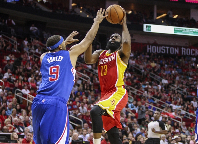 Mar 29, 2014; Houston, TX, USA; Houston Rockets guard James Harden (13) drives the ball to the basket during the first quarter as Los Angeles Clippers forward Jared Dudley (9) defends at Toyota Center. Mandatory Credit: Troy Taormina-USA TODAY Sports