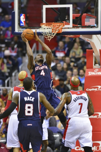Mar 29, 2014; Washington, DC, USA; Washington Wizards center Marcin Gortat (4) lays the ball in the basket during the second quarter against the Washington Wizards at Verizon Center. Mandatory Credit: Tommy Gilligan-USA TODAY Sports
