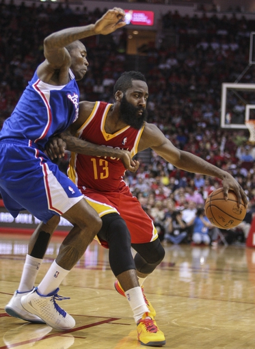 Mar 29, 2014; Houston, TX, USA; Houston Rockets guard James Harden (13) attempts to control the ball during the second quarter as Los Angeles Clippers guard Jamal Crawford (11) defends at Toyota Center. Mandatory Credit: Troy Taormina-USA TODAY Sports