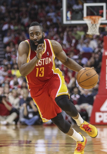 Mar 29, 2014; Houston, TX, USA; Houston Rockets guard James Harden (13) drives the ball during the second quarter against the Los Angeles Clippers at Toyota Center. Mandatory Credit: Troy Taormina-USA TODAY Sports