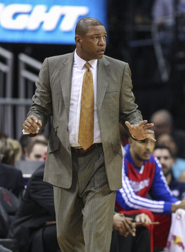 Mar 29, 2014; Houston, TX, USA; Los Angeles Clippers head coach Doc Rivers coaches from the sideline during the first quarter against the Houston Rockets at Toyota Center. Mandatory Credit: Troy Taormina-USA TODAY Sports