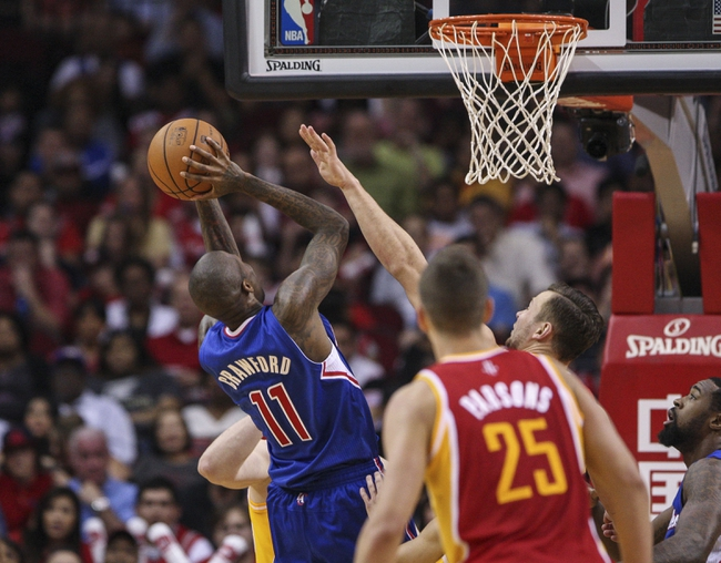 Mar 29, 2014; Houston, TX, USA; Los Angeles Clippers guard Jamal Crawford (11) shoots during the second quarter against the Houston Rockets at Toyota Center. Mandatory Credit: Troy Taormina-USA TODAY Sports