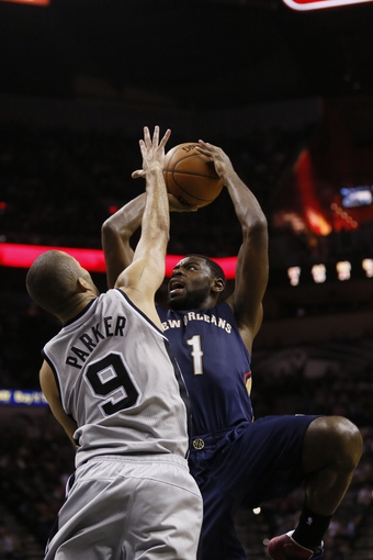 Mar 29, 2014; San Antonio, TX, USA; New Orleans Pelicans forward Tyreke Evans (1) shoots the ball over San Antonio Spurs guard Tony Parker (9) during the first half at AT&T Center. Mandatory Credit: Soobum Im-USA TODAY Sports