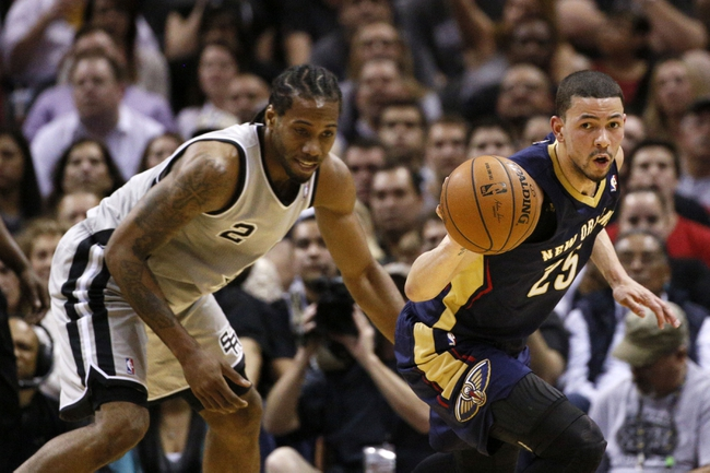 Mar 29, 2014; San Antonio, TX, USA; San Antonio Spurs forward Kawhi Leonard (2) has the ball stolen by New Orleans Pelicans guard Austin Rivers (25) during the first half at AT&T Center. Mandatory Credit: Soobum Im-USA TODAY Sports