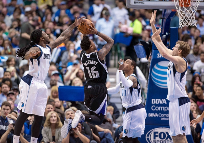 Mar 29, 2014; Dallas, TX, USA; Dallas Mavericks forward Jae Crowder (9) and guard Monta Ellis (11) and forward Dirk Nowitzki (41) defend against Sacramento Kings guard Ben McLemore (16) during the first half at the American Airlines Center. Mandatory Credit: Jerome Miron-USA TODAY Sports