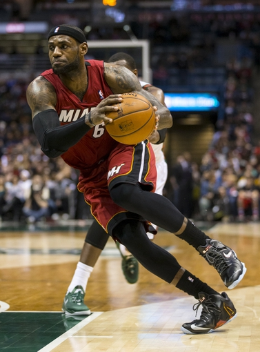 Mar 29, 2014; Milwaukee, WI, USA; Miami Heat forward LeBron James (6) drives for the basket during the second quarter against the Milwaukee Bucks at BMO Harris Bradley Center. Mandatory Credit: Jeff Hanisch-USA TODAY Sports