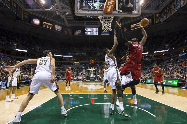 Mar 29, 2014; Milwaukee, WI, USA; Miami Heat forward LeBron James (6) loses the ball as Milwaukee Bucks forward Khris Middleton (22) defends during the third quarter at BMO Harris Bradley Center. Mandatory Credit: Jeff Hanisch-USA TODAY Sports