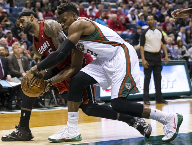 Mar 29, 2014; Milwaukee, WI, USA; Miami Heat forward LeBron James (6) and Milwaukee Bucks forward Jeff Adrien (12) battle for control of the ball during the third quarter at BMO Harris Bradley Center. Mandatory Credit: Jeff Hanisch-USA TODAY Sports