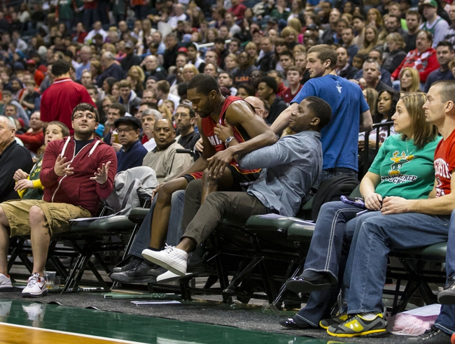 Mar 29, 2014; Milwaukee, WI, USA; Miami Heat guard Toney Douglas (0) falls into the first row of seating during the third quarter against the Milwaukee Bucks at BMO Harris Bradley Center. Mandatory Credit: Jeff Hanisch-USA TODAY Sports