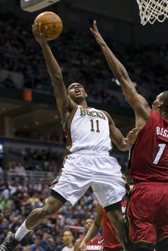 Mar 29, 2014; Milwaukee, WI, USA; Milwaukee Bucks guard Brandon Knight (11) shoots against Miami Heat center Chris Bosh (1) during the third quarter at BMO Harris Bradley Center. Mandatory Credit: Jeff Hanisch-USA TODAY Sports