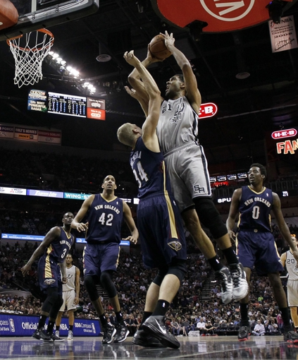 Mar 29, 2014; San Antonio, TX, USA; San Antonio Spurs forward Tim Duncan (21) shoots as New Orleans Pelicans center Greg Stiemsma (34) defends during the second half at AT&T Center. Mandatory Credit: Soobum Im-USA TODAY Sports