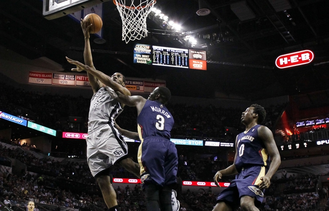 Mar 29, 2014; San Antonio, TX, USA; San Antonio Spurs forward Kawhi Leonard (2) shoots while being defended by New Orleans Pelicans guard Anthony Morrow (3) during the second half at AT&T Center. Mandatory Credit: Soobum Im-USA TODAY Sports