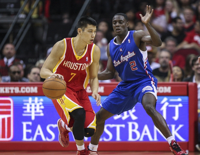 Mar 29, 2014; Houston, TX, USA; Houston Rockets guard Jeremy Lin (7) controls the ball during the fourth quarter as Los Angeles Clippers guard Darren Collison (2) defends at Toyota Center. The Clippers defeated the Rockets 118-107. Mandatory Credit: Troy Taormina-USA TODAY Sports