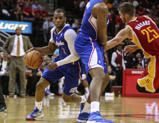 Mar 29, 2014; Houston, TX, USA; Los Angeles Clippers guard Chris Paul (3) drives the ball during the fourth quarter against the Houston Rockets at Toyota Center. The Clippers defeated the Rockets 118-107. Mandatory Credit: Troy Taormina-USA TODAY Sports