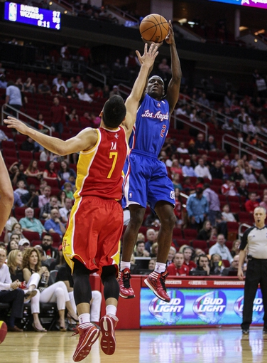 Mar 29, 2014; Houston, TX, USA; Los Angeles Clippers guard Darren Collison (2) shoots during the fourth quarter as Houston Rockets guard Jeremy Lin (7) defends at Toyota Center. The Clippers defeated the Rockets 118-107. Mandatory Credit: Troy Taormina-USA TODAY Sports