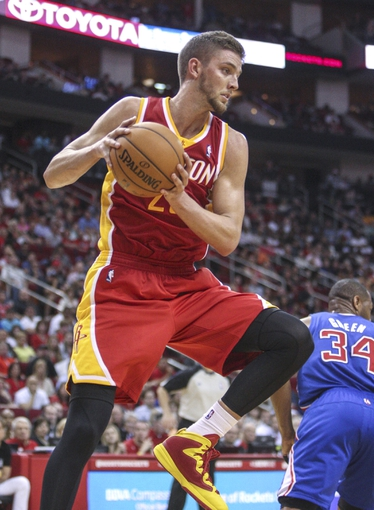 Mar 29, 2014; Houston, TX, USA; Houston Rockets forward Chandler Parsons (25) gets a rebound during the fourth quarter against the Los Angeles Clippers at Toyota Center. The Clippers defeated the Rockets 118-107. Mandatory Credit: Troy Taormina-USA TODAY Sports