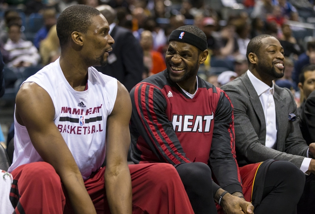 Mar 29, 2014; Milwaukee, WI, USA; Miami Heat forward LeBron James (6) and center Chris Bosh (1) enjoy a moment on the bench during the fourth quarter against the Milwaukee Bucks at BMO Harris Bradley Center.  Miami won 88-67.  Mandatory Credit: Jeff Hanisch-USA TODAY Sports