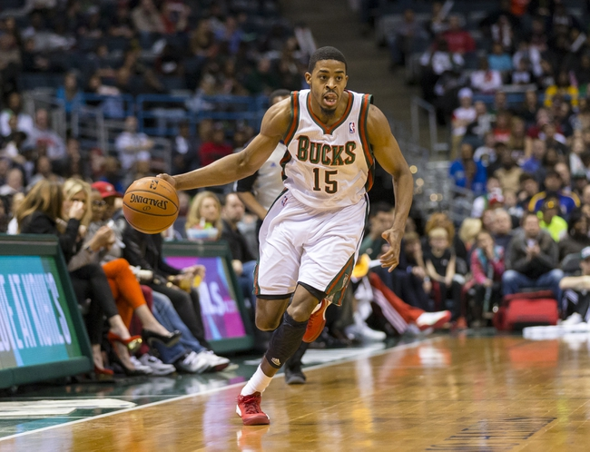 Mar 29, 2014; Milwaukee, WI, USA; Milwaukee Bucks guard D.J. Stephens (15) dribbles the ball during the fourth quarter against the Miami Heat at BMO Harris Bradley Center.  Miami won 88-67.  Mandatory Credit: Jeff Hanisch-USA TODAY Sports