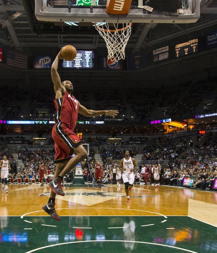Mar 29, 2014; Milwaukee, WI, USA; Miami Heat forward Rashard Lewis (9) drives for a layup during the fourth quarter against the Milwaukee Bucks at BMO Harris Bradley Center.  Miami won 88-67.  Mandatory Credit: Jeff Hanisch-USA TODAY Sports