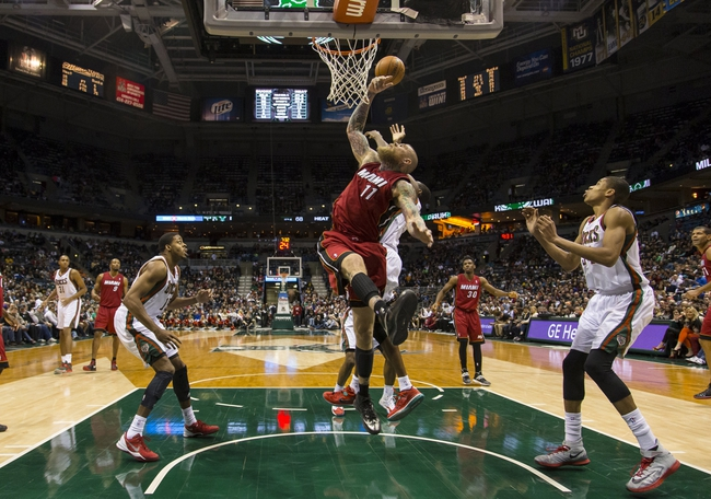 Mar 29, 2014; Milwaukee, WI, USA; Miami Heat forward Chris Andersen (11) reaches back for the ball during the fourth quarter against the Milwaukee Bucks at BMO Harris Bradley Center.  Miami won 88-67.  Mandatory Credit: Jeff Hanisch-USA TODAY Sports