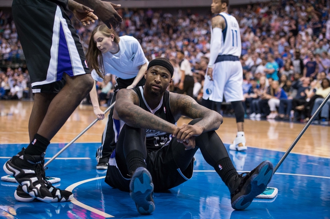 Mar 29, 2014; Dallas, TX, USA; Sacramento Kings center DeMarcus Cousins (15) reacts to being knocked to the floor during the second half against the Dallas Mavericks at the American Airlines Center. The Mavericks defeated the Kings 103-100. Mandatory Credit: Jerome Miron-USA TODAY Sports