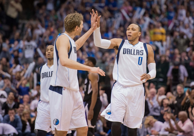 Mar 29, 2014; Dallas, TX, USA; Dallas Mavericks forward Dirk Nowitzki (41) congratulates forward Shawn Marion (0) after Marion makes a three point shot against the Sacramento Kings during the second half at the American Airlines Center. The Mavericks defeated the Kings 103-100. Mandatory Credit: Jerome Miron-USA TODAY Sports