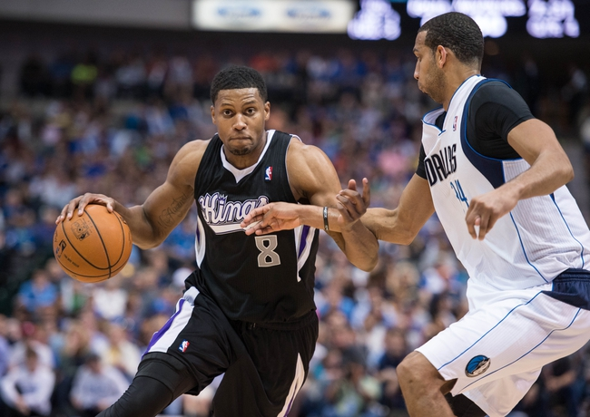 Mar 29, 2014; Dallas, TX, USA; Sacramento Kings forward Rudy Gay (8) drives to the basket past Dallas Mavericks forward Brandan Wright (34) during the second half at the American Airlines Center. Gay leads his team with 30 points. The Mavericks defeated the Kings 103-100. Mandatory Credit: Jerome Miron-USA TODAY Sports