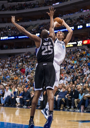 Mar 29, 2014; Dallas, TX, USA; Dallas Mavericks forward Dirk Nowitzki (41) shoots over Sacramento Kings forward Travis Outlaw (25) during the first half at the American Airlines Center. Nowitzki leads his team with 19 points. The Mavericks defeated the Kings 103-100. Mandatory Credit: Jerome Miron-USA TODAY Sports