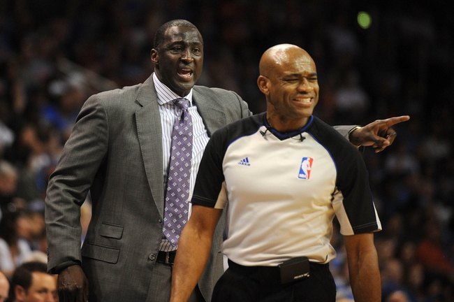 Mar 30, 2014; Oklahoma City, OK, USA; Utah Jazz head coach Tyrone Corbin discusses a call with NBA official Tre Maddox in action against the Oklahoma City Thunder at Chesapeake Energy Arena. Mandatory Credit: Mark D. Smith-USA TODAY Sports