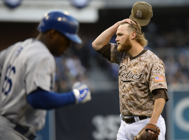 Mar 30, 2014; San Diego, CA, USA; San Diego Padres starting pitcher Andrew Cashner (34) reacts after walking Los Angeles Dodgers right fielder Yasiel Puig (66) in the fifth inning on the opening day baseball game at Petco Park. Mandatory Credit: Christopher Hanewinckel-USA TODAY Sports