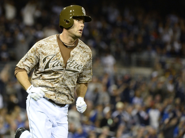 Mar 30, 2014; San Diego, CA, USA; San Diego Padres pinch hitter Seth Smith (12) watches a solo home run in the eighth inning  on the opening day baseball game against the Los Angeles Dodgers at Petco Park. Mandatory Credit: Christopher Hanewinckel-USA TODAY Sports