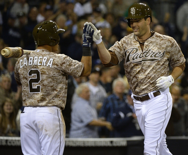 Mar 30, 2014; San Diego, CA, USA; San Diego Padres pinch hitter Seth Smith (12) celebrates with shortstop Everth Cabrera (2) following a solo home run in the eighth inning  on the opening day baseball game against the Los Angeles Dodgers at Petco Park. Mandatory Credit: Christopher Hanewinckel-USA TODAY Sports