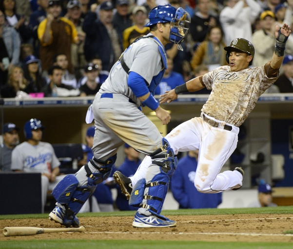 Mar 30, 2014; San Diego, CA, USA; San Diego Padres shortstop Everth Cabrera (2) scores ahead of a play by Los Angeles Dodgers catcher A.J. Ellis (17) in the eighth inning  on the opening day baseball game at Petco Park. Mandatory Credit: Christopher Hanewinckel-USA TODAY Sports