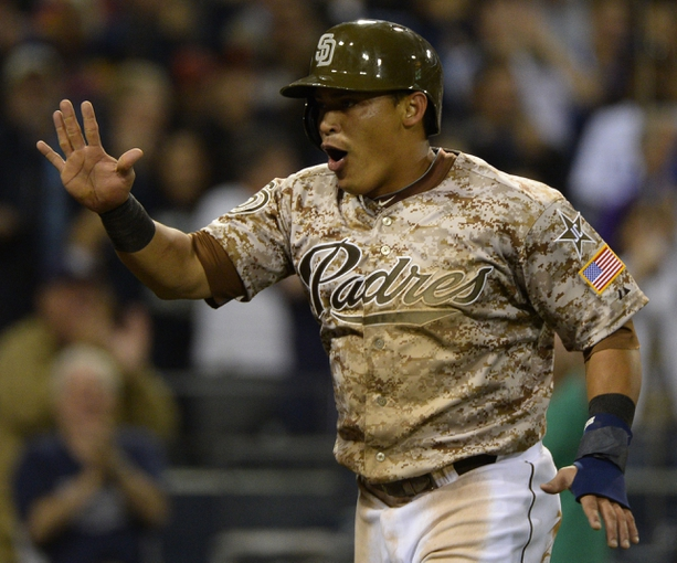 Mar 30, 2014; San Diego, CA, USA; San Diego Padres shortstop Everth Cabrera (2) celebrates after scoring in the eighth inning on the opening day baseball game against the Los Angeles Dodgers at Petco Park. Mandatory Credit: Christopher Hanewinckel-USA TODAY Sports