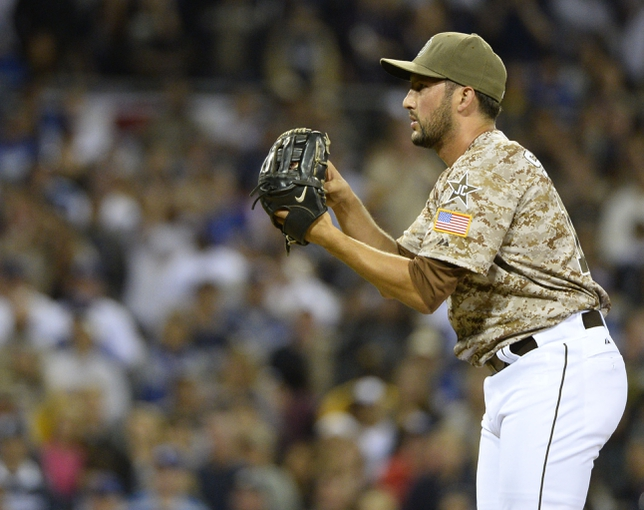 Mar 30, 2014; San Diego, CA, USA; San Diego Padres relief pitcher Huston Street (16) prepares to throw the ball in the ninth inning  on the opening day baseball game against the Los Angeles Dodgers at Petco Park. The Padres won 3-1. Mandatory Credit: Christopher Hanewinckel-USA TODAY Sports