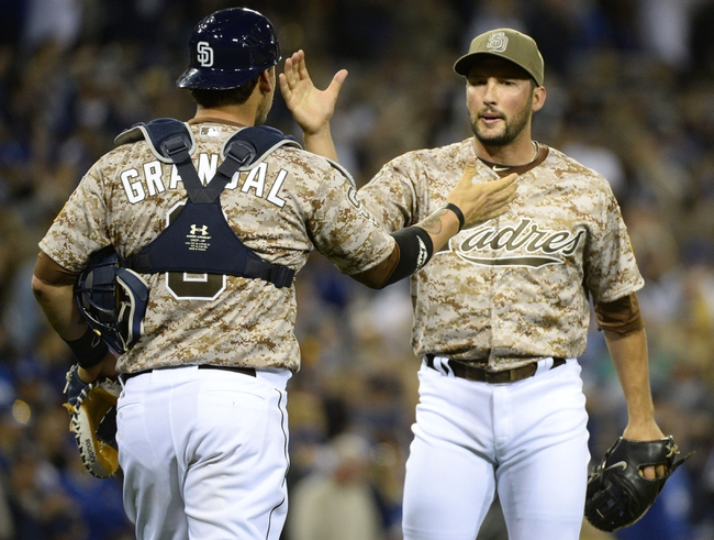 Mar 30, 2014; San Diego, CA, USA; San Diego Padres relief pitcher Huston Street (16) celebrates with catcher Yasmani Grandal (8) after winning the opening day baseball game against the Los Angeles Dodgers at Petco Park. The Padres won 3-1. Mandatory Credit: Christopher Hanewinckel-USA TODAY Sports
