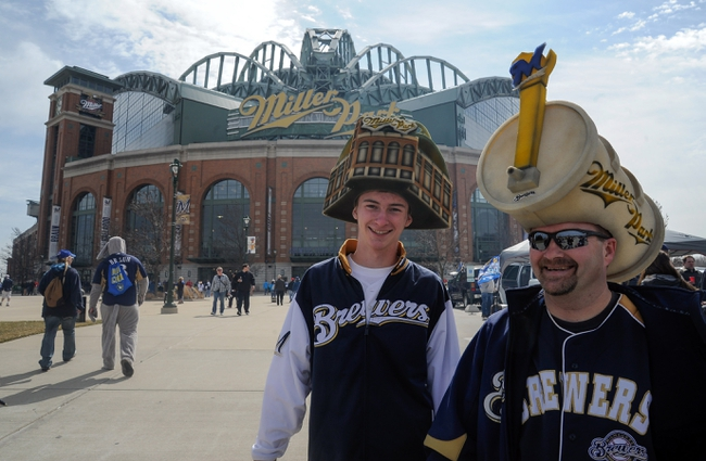 Mar 31, 2014; Milwaukee, WI, USA;   Mike Nichols (right) and his son Zach Nichols arrives for an opening day baseball game between the Milwaukee Brewers and Atlanta Braves at Miller Park. Mandatory Credit: Benny Sieu-USA TODAY Sports