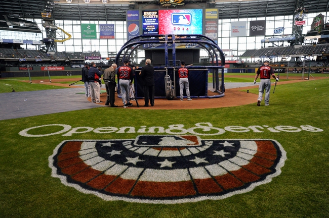 Mar 31, 2014; Milwaukee, WI, USA;   The Atlanta Braves takes batting practice before an opening day baseball game against the Milwaukee Brewers at Miller Park. Mandatory Credit: Benny Sieu-USA TODAY Sports
