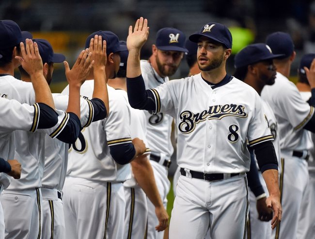 Mar 31, 2014; Milwaukee, WI, USA;  Milwaukee Brewers left fielder Ryan Braun (8) is introduced to fans before an opening day baseball game against the Atlanta Braves at Miller Park. Mandatory Credit: Benny Sieu-USA TODAY Sports
