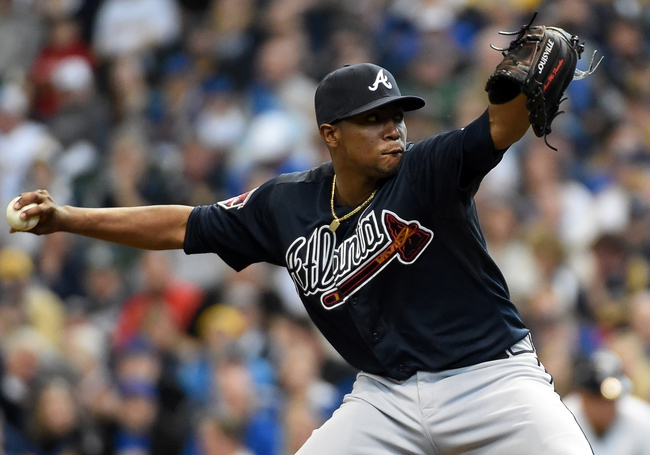 Mar 31, 2014; Milwaukee, WI, USA;   Atlanta Braves pitcher Julio Teheran (49) pitches in the first inning against the Milwaukee Brewers of an opening day baseball game at Miller Park. Mandatory Credit: Benny Sieu-USA TODAY Sports
