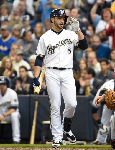 Mar 31, 2014; Milwaukee, WI, USA;   Milwaukee Brewers left fielder Ryan Braun (8) reacts to fans before his first at bat in the first inning against the Atlanta Braves of an opening day baseball game at Miller Park. Mandatory Credit: Benny Sieu-USA TODAY Sports