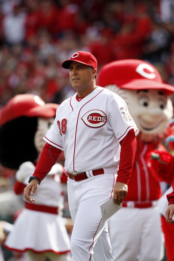 Mar 31, 2014; Cincinnati, OH, USA; Cincinnati Reds manager Bryan Price (38) brings the line up card to home plate prior to the game against the St. Louis Cardinals at Great American Ball Park. Mandatory Credit: Frank Victores-USA TODAY Sports