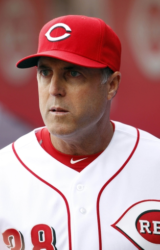 Mar 31, 2014; Cincinnati, OH, USA; Cincinnati Reds manager Bryan Price (38) in the dugout  during the second inning against the St. Louis Cardinals at Great American Ball Park. Mandatory Credit: Frank Victores-USA TODAY Sports