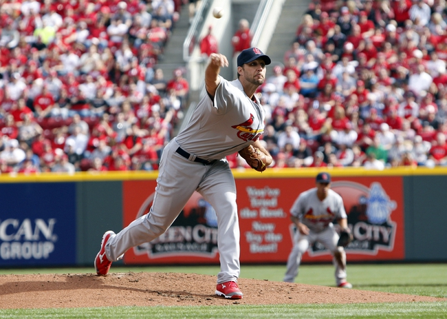 Mar 31, 2014; Cincinnati, OH, USA; St. Louis Cardinals starting pitcher Adam Wainwright (50) pitches during the first inning against the Cincinnati Reds at Great American Ball Park. Mandatory Credit: Frank Victores-USA TODAY Sports