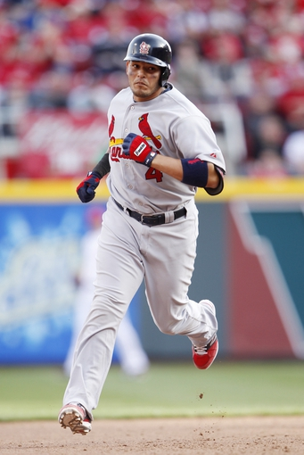 Mar 31, 2014; Cincinnati, OH, USA; St. Louis Cardinals catcher Yadier Molina (4) rounds to second base after hitting a home run during the seventh inning against the Cincinnati Reds at Great American Ball Park. The Cardinals won 1-0. Mandatory Credit: Frank Victores-USA TODAY Sports